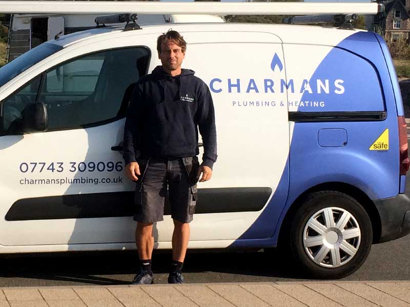 Wayne Charman posing next to his Van